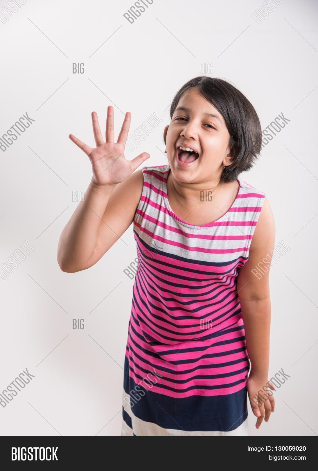 indian small girl counting five, asian small girl showing 5 fingers or five  numbers with
