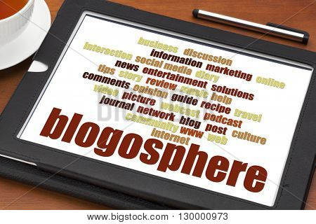 blogosphere word cloud on a digital tablet with a cup of tea - blogging concept