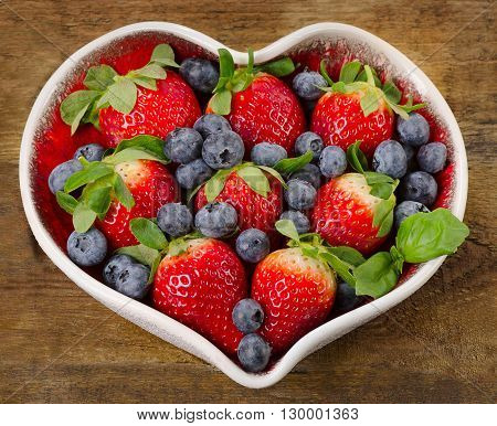 Berries In Heart Shaped Bowl.