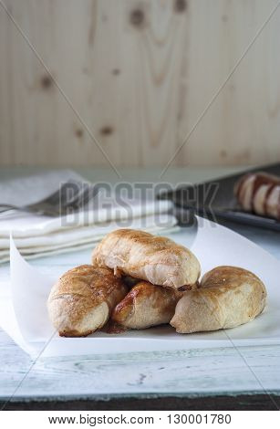 Sweet puffs on wooden table, vertical view