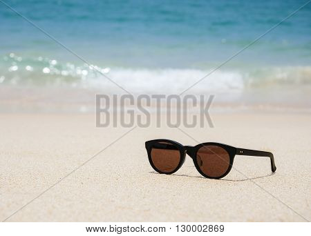 Sunglasses on the beach Summer Holiday background