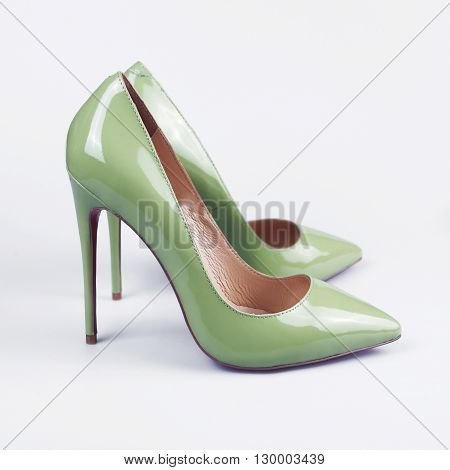 Green High Heel Women Shoes On White Background.