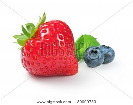 Strawberry, blueberries and mint leaf, isolated on white.