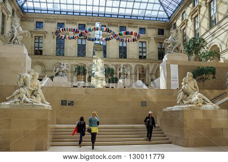 """Paris, Framce - May 12: This is courtyard of the Louvre glass-covered and named in honor of Marley's Court a unique sculptural group Guillaume Coustou """"Horse Tamers"""" May 12, 2013 in Paris, France."""