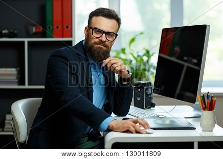 Handsome young man working from home office - modern business concept