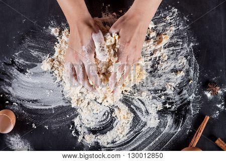 Making of cookies with ingredients like eggs flour cinnamon anise rolling pin paper on blackboard