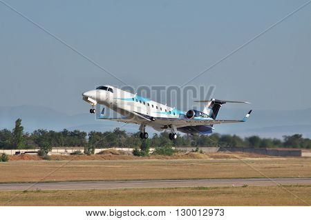 Simferopol Ukraine - September 12 2010: Embraer EMB-135BJ business jet is taking off from the runway in the airport