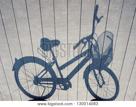 Bicycle shadow on Wooden plank Art abstract background
