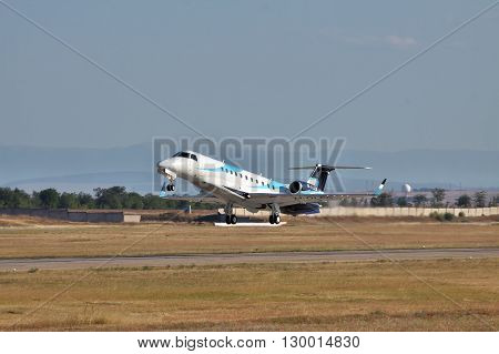 Simferopol Ukraine - September 12 2010: Embraer EMB-135BJ business jet is taking off from the runway in the evening