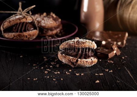 Italian maroni cookies with pieces of chocolate on old wooden background