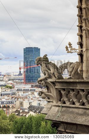 Paris, France - May 13: These are statues of chimeras are installed on the top floor at the foot of the towers of Notre-Dame de Paris May 13, 2013 Paris, France.