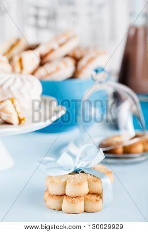 Cookies milkshakes jar of candies flower and gifts in blue
