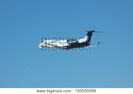 Simferopol Ukraine - September 12 2010: Embraer EMB-135BJ business jet is taking off from the airport into the blue sky