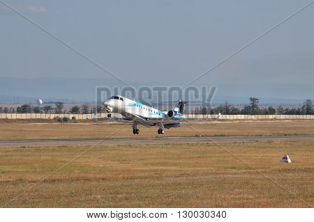 Simferopol Ukraine - September 12 2010: Embraer EMB-135BJ business jet is taking off from the runway