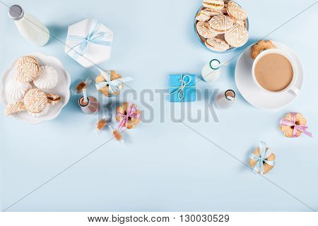 Cookies milkshake gift and sweets on blue background from the top