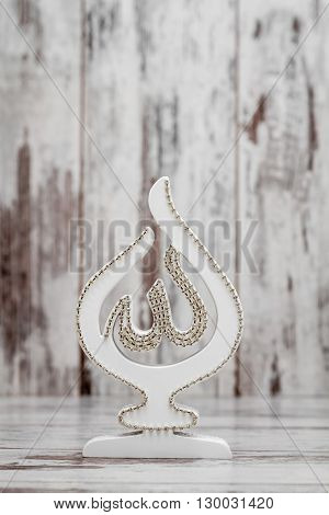 White Religious Statuette With The Name Of Allah