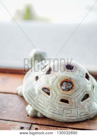 Turtle shape designed ash tray with blurred white background