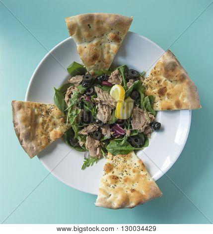 Tuna salad with ruccola and garlic focaccia