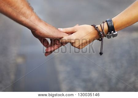Romantic couple holding hands on travel. Love and travel concept