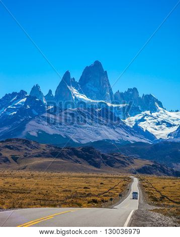 Argentine Patagonia. Sunny day in February. Fine concrete highway to the majestic Mount Fitz Roy