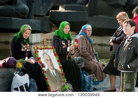Kyiv, Ukraine - May 8, 2009: Senior woman veterans sit besides portrait of Georgy Zhukov during Victory Day celebration at the Museum of The History of Ukraine in World War II in Kyiv