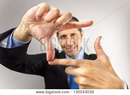 business man with hands symbol that means frame over white background
