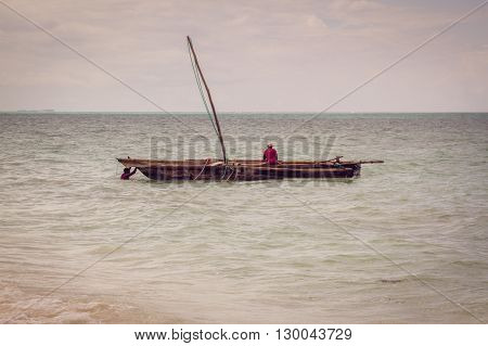 Fishermen on a dhow in Zanzibar Island