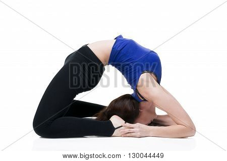 Young beautiful caucasian woman in yoga pose in studio isolated on white background. Sexy female body