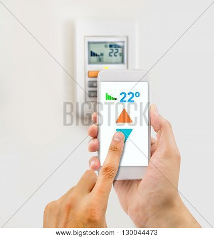regulating the temperature from the smartphone and controlling the digital thermostat with finger pressing button