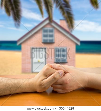 female hands grasping the concept of a man in love on the beach. All screen content is designed by me and not copyrighted by others and created with wacom tablet and ps