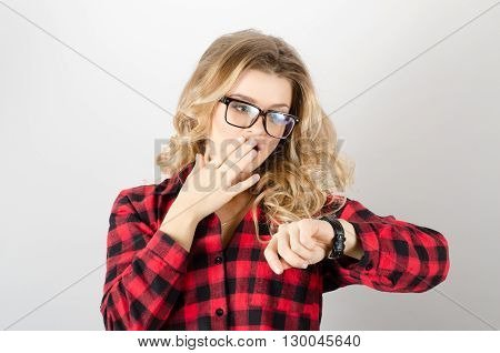 Woman In Glasses Looking At Wrist Watch, Late