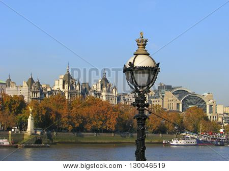 View from Embankment in London with river Thames and stylish street latern.