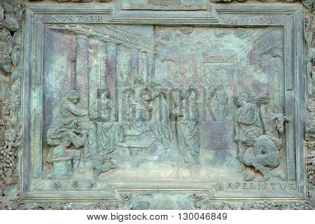 PISA, ITALY - JUNE 06, 2015: Visitation of the Virgin Mary, detail of the central door of the Cathedral St. Mary of the Assumption in Pisa, Italy on June 06, 2015