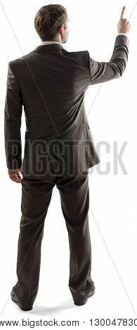 Rear view of young business man pointing at copy space isolated over white background. Full length portrait of businessman standing back