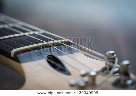 Guitar riff with strings and tuning knobs poster