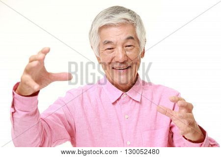 portrait of senior Japanese man with supernatural power on white background