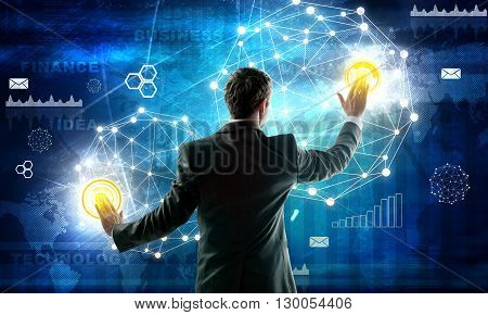 Business man in grey suit working with digital virtual screen. Technology concept