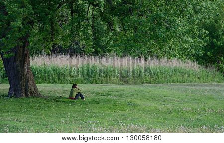 Woman Relaxing At The Rirdale Park In Toronto