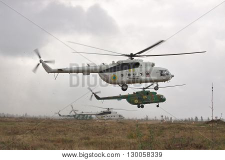 Zhitomir Ukraine - September 29 2010: Ukrainian Army military transport helicopter is landing under the thunderstorm during the military trainings