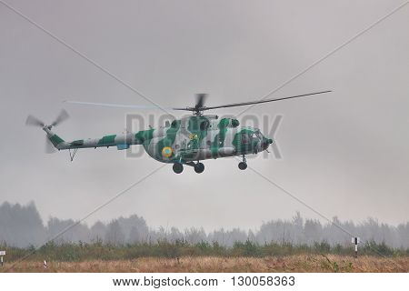 Zhitomir Ukraine - September 29 2010: Ukrainian Army military transport helicopter is landing in heavy storm during the military trainings