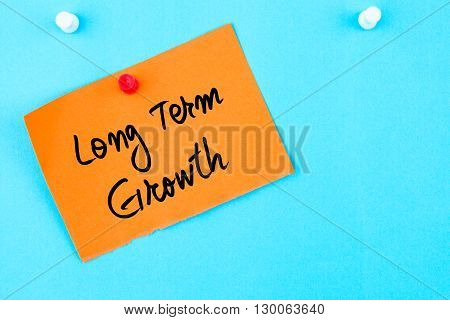 Long Term Growth Written On Orange Paper Note