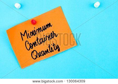 Minimum Container Quantity Written On Orange Paper Note