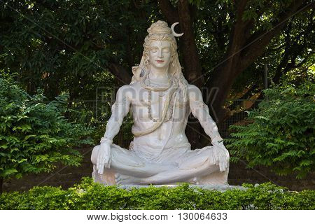 Shiva statue hindu idol near on the river Ganges Rishikesh India