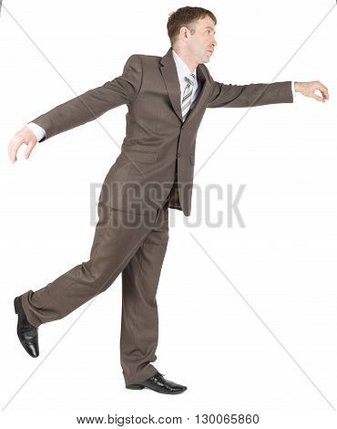 Businessman balancing on one leg isolated on white background