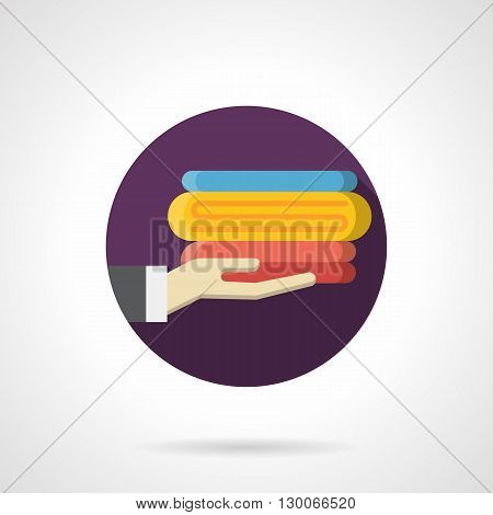 Hand holds a stack of colorful towels. Cotton towels for bath. Shopping sign, hotel service with choice and quality, hygiene means. Round flat color style vector icon.