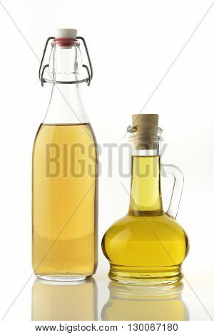 Apple Cider Vinegar and Cooking Oil on White Background