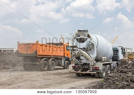 Dumper truck is going to unload soil or sand at construction site.