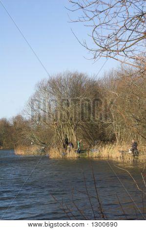 Fishermen Fishing At Lakeside