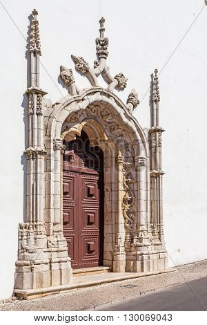 Portal in the Manuelino or Manueline style of Nossa Senhora de Marvila Church. 16th century Renaissance and architecture. Santarem, Portugal.