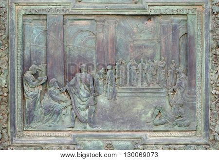 PISA, ITALY - JUNE 06, 2015: Wedding of the Virgin Mary, work from Giambologna's school, central portal of the Cathedral St. Mary of the Assumption in Pisa, Italy on June 06, 2015
